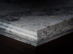 Granite edge on dark cabinet